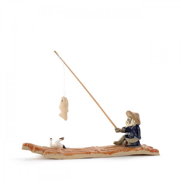 Bambusfloß mit Angler