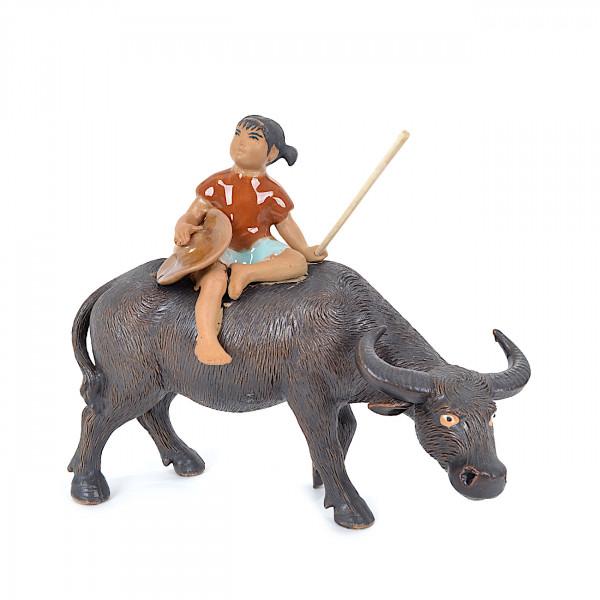 Büffel mit Mädchen